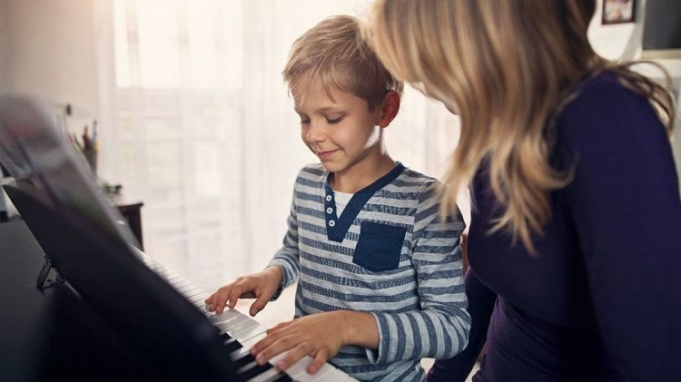 Child With Autism Playing Piano