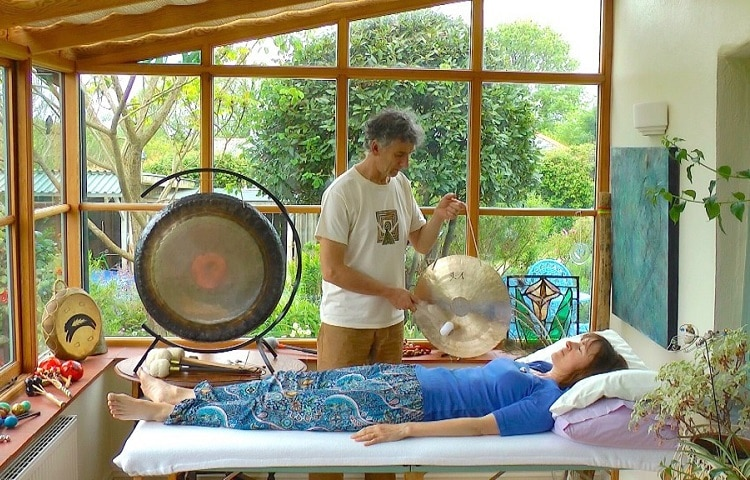 man playing gong at the sound therapy